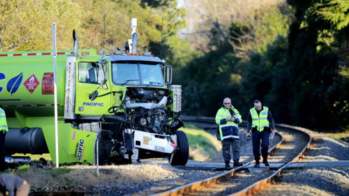 Damaged tanker at rail lines in NZ after collision with train