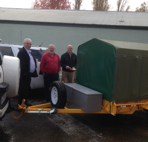 Paul Harrison of TISC, CROIERG Chairman Paul Pulver & TISC CEO Ken Brennan at changeover of new trailer bund for Melbourne