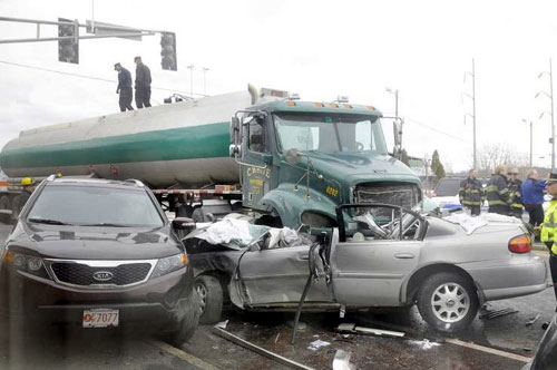 Wrecked car and tanker