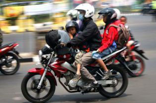A family on a motor cycle